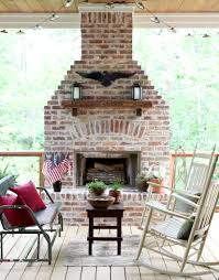 Outdoor brick fireplace with mantel.