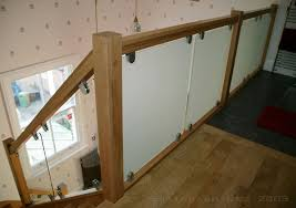 vision glass barading with oak handrail