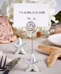 beach themed starfish and seashell placecard holders fish and beach Beach Themed Wedding Place Cards shimmering starfish design place card holder favors beach themed place cards for wedding