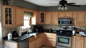 kitchen cabinets before custom painting in frederick maryland