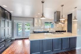 contemporary kitchen with white zeus quartz counters and dark cabinets with white backsplash