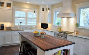 white and yellow kitchen with white porcelain diamond tiled backsplash ery yellow walls and crisp white shaker cabinetry paired with coast green