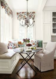 banquette furniture with storage. pillows and drapes add color freshness to the all white banquette from erica furniture with storage