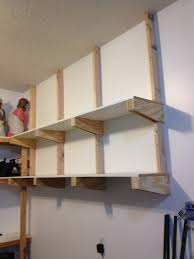 garage remodel design with custom diy wood wall mounted storage shelves using reclaimed wood for small garage spaces ideas