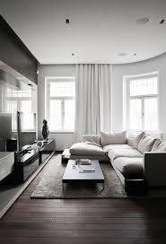 modern dark oak laminate floors here make the minimalist living room looks cozy