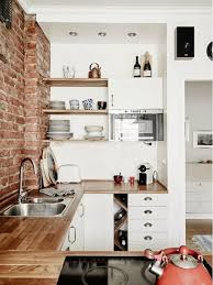 Kitchen: Black Kitchen With Pink Pastel Brick Wall - Exposed Brick Walls