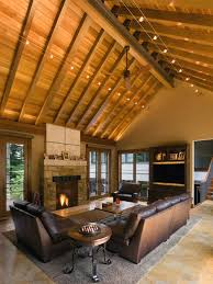 best lighting for cathedral ceilings. example of a mountain style living room design in cleveland with stone fireplace best lighting for cathedral ceilings t