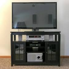 wood corner television stand in black with 175 lb weight capacity