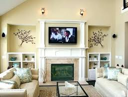tv over fireplace where to put components mounting above fireplace how to mount television over fireplace