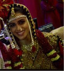 genelia dsouza genelia had a typical maharashtrian style wedding the couple wore the traditional headgears she wore a red sari designed by neeta lulla
