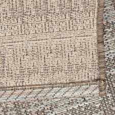 outdoor indoor woven rug distressed design with shades of gray steel blue silver