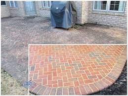brick patio before pressure washing and