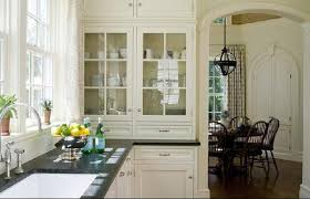 glass front kitchen cabinets. ivory kitchen glass-front cabinets, polished chrome fixtures and black countertops. glass front cabinets b