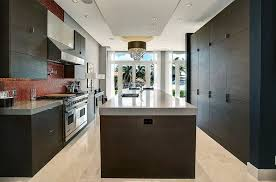 contemporary kitchen with dark cabinets gray quartz countertops and large center island