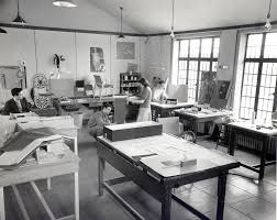 View of the design department with students. Charles Eames (center) is  crouched on