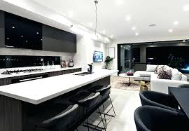 modern black kitchen modern kitchen with black cabinets white counters and breakfast bar modern dark kitchen modern black kitchen