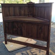Stained walnut, before painted soft white and distressed. Corner queen  headboard that I built