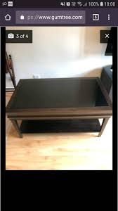 solid wood coffee table glass top