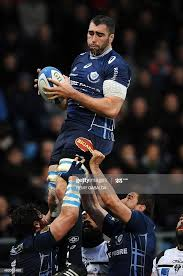Castres French lock Benjamin Desroches grabs the ball in a line ...