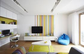 Simple Interior Design Living Room Wonderful Simple Living Room With Rainbow Striped Wall Decal
