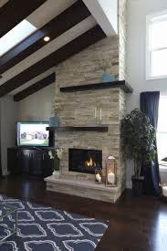 middot kitchen island corbel makeover  birchwood parade home floor to ceiling stacked stone gas fireplace