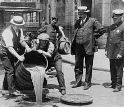 「Orange County Sheriff's deputies dumping illegal booze, Santa Ana, on March 31,1932」の画像検索結果