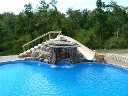 In ground pools with waterfalls Natural Stone Inground Pool Slides Built In Swimming Pool Slides Custom Waterfall And Slide All Rock Was Hand Crismateccom Inground Pool Slides Printjobzcom