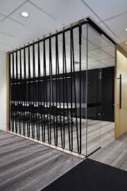 interior office partitions. creative use of ropes to provide some privacy for the conference room without blocking too much office interior partitions