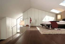 Huge closets - Elegant white Bedroom in the attic with a large dressing room