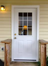 white front door with glass. A Simple White Steel Provia Side Entry Door With Two Embossed Panels And Half Glass Front