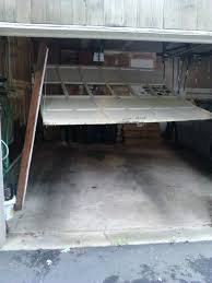 garage door accidents why they happen damaged garage door3 jpg