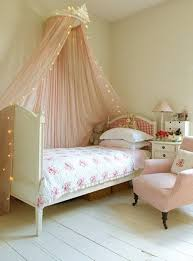 Pink Chair For Bedroom Pink Kids Bed Canopy Decorated With String Lights In A Bedroom