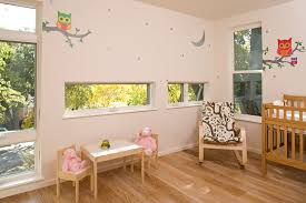 inspired owl wall decals in nursery contemporary with neutral nursery next to poang chair alongside ribbon decorating and changing table