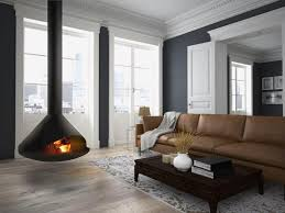 Cone suspended wood burning fireplace is hand forged to order and ideal for  spaces that require