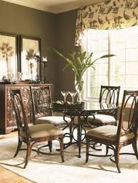 tropical dining room furniture. Modren Room A Fancifully Scrolled Metal Base Energizes The Look Of Your Dining Set  Bringing Class And  Tropical Style DecorTropical InteriorMetal Dining TableDining  With Room Furniture