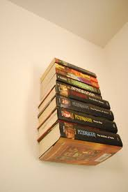picture of how to make an invisible bookshelf without ruining a book