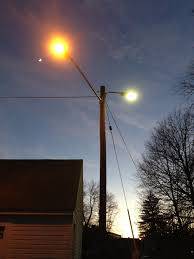 file 2016 12 26 17 05 23 sodium vapor and mercury vapor street lights just after turning on for the night on the same utility pole along an alley adjacent