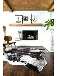 large cowhide rug ideas best faux on rustic pads extra uk