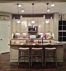 island lighting for kitchen. Three Laps Island Lighting Pendants Terrific Ideas White Color Granite Also Browncountertop Bar Stool Wooden Floor For Kitchen O