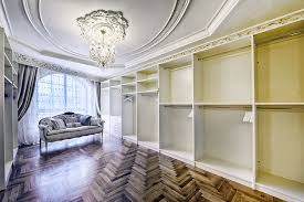 empty walk in closet. Luxury Walk In Closet With Chandelier And Wood Flooring Empty