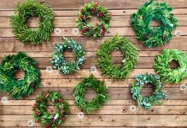 the wreath wall is back while we love a fresh wreath artificial can be so easy in care no care and lasts year to year whether you prefer a plain and