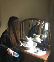 ylang ylang calming the panic of love memory essay 5 of godin brushing hair reflected in antique vanity mirror