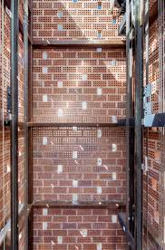 Perforated Brick Wall Design Featuring Walls Of Perforated Brickwork This Elevator Is