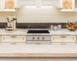 Wooden Textured Table Over Blurred Kitchen Stove Interior Background