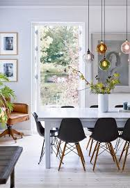scandinavian dining room with beautiful flowers and branches from the garden