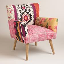 an eclectic mix of prints and colors gives our accent chair a