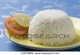 plate of white rice. Delighful Plate Closeup Of White Rice In A Plate With Slices Lemon And Tomato For Plate Of White Rice
