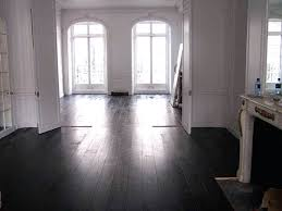 painting hardwood floors black white painted wall color also large glass curved top windows with dark