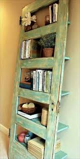 this old door has been given a new life and brings an organic and rustic feeling to the living room diy rawmaterials