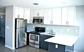 two tone black and white kitchen cabinets lower upper cabinet stunning kitchen features white upper cabinets